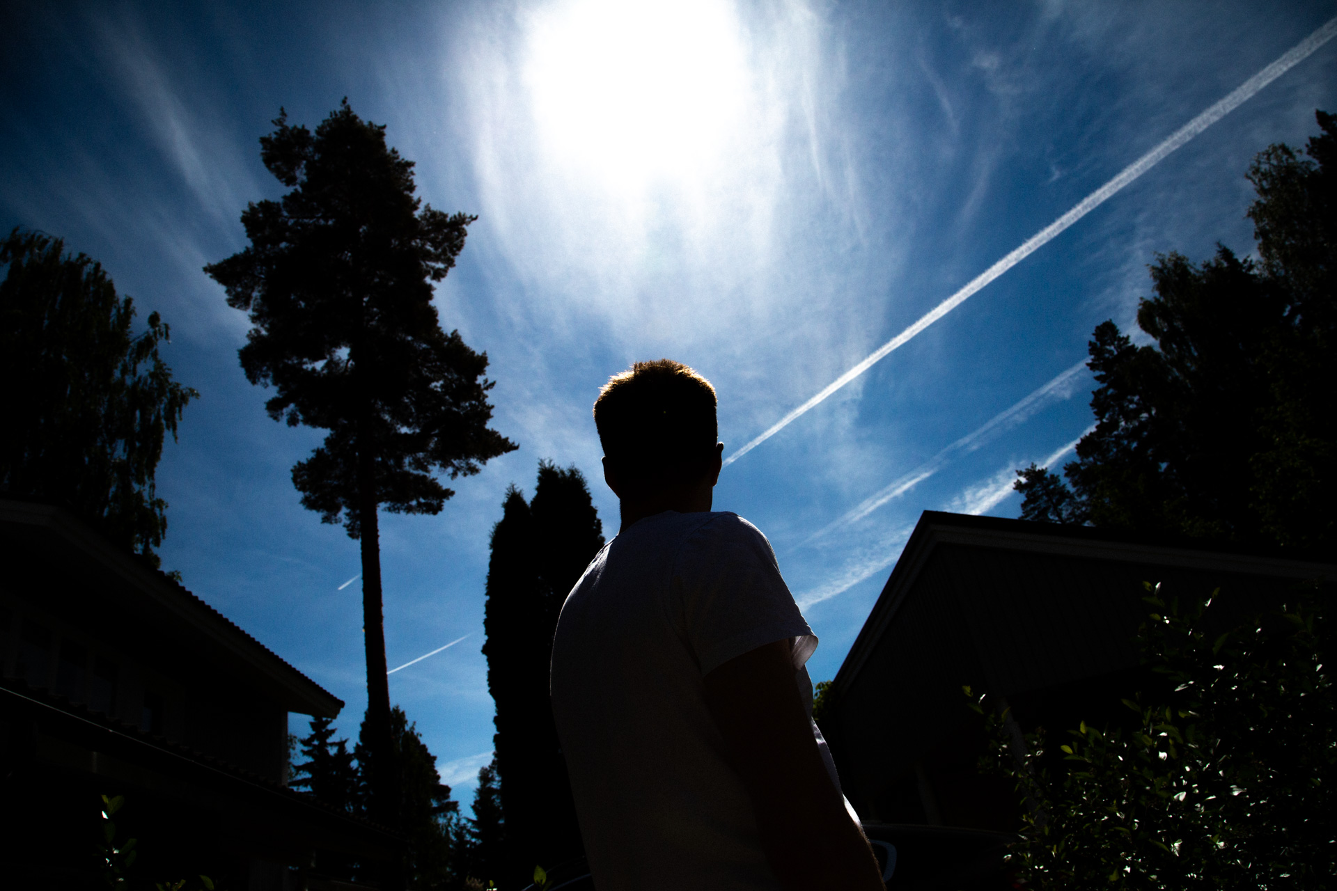 Photographer's brother observing water vapor tracks above his parents' house in Lappeenranta.