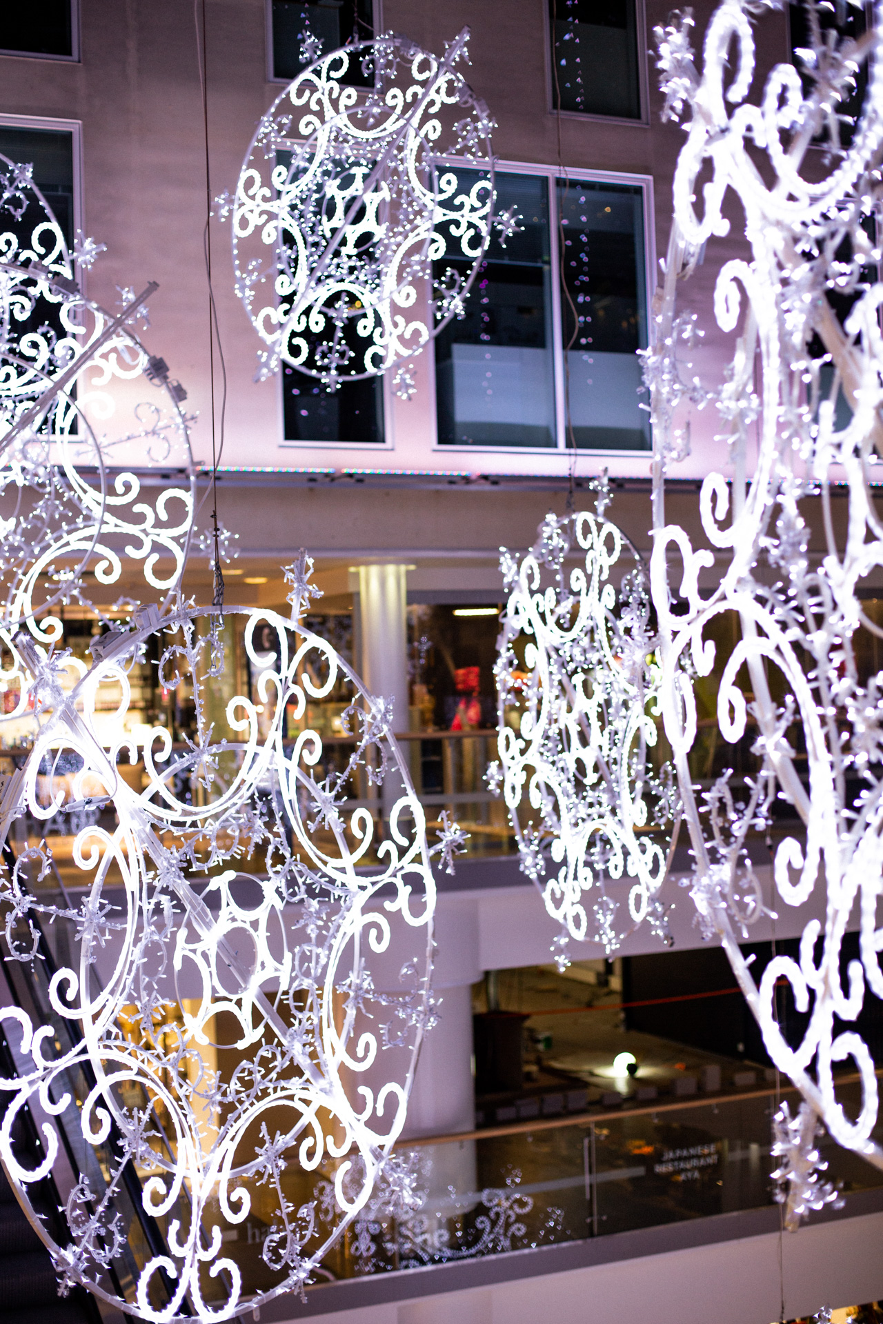 Artificial snow flake decorations in the shopping center City Center in Helsinki, Finland.