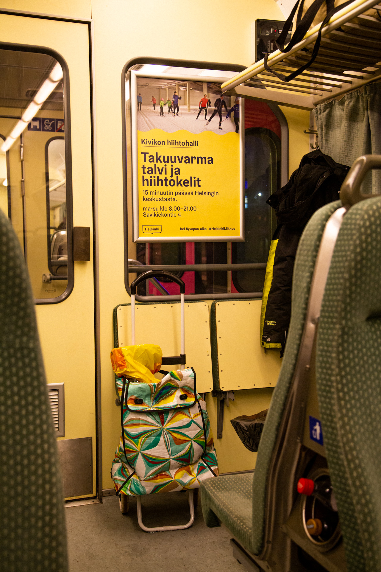 An advertisement on guaranteed winter in an indoor skiing hall on a commuter train.